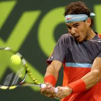 Getting it done in Doha: Rafael Nadal plays a shot from France's Gael Monfils in the final of the Qatar Open on Saturday. Nadal won 6-1, 6-7 (5-7), 6-2. | AFP-JIJI