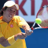 Wins in five: Kei Nishikori plays a shot from Marinko Matosevic in their first-round match at the Australian Open on Tuesday. | AFP-JIJI