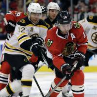 Blackhawks top Bruins in shootout