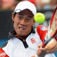Into final four: Kei Nishikori plays a shot from Croatia's Marin Cilic in their quarterfinal match at the Brisbane International on Friday. Nishikori won 6-4, 5-7, 6-2. | AFP-JIJI
