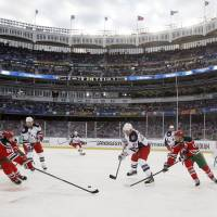 Cold front: The New York Rangers and New Jersey Devils play at Yankee Stadium on Sunday in New York. The Rangers routed the Devils 7-3. | AP