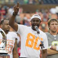 The winning touch: Jerry Rice addresses the crowd after his team edged Team Sanders at the Pro Bowl in Honolulu. | AP