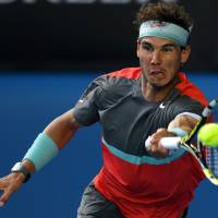 Master at work: Rafael Nadal plays a shot during his Australian Open fourth-round win over Kei Nishikori on Monday. | AP