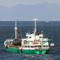 Freighter, trawlers collide, leaving two fishermen dead