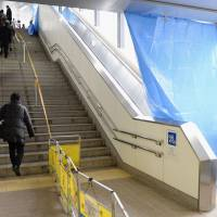 Out of step: An escalator in Musashikosugi Station in Kawasaki remains out of commission Wednesday after it came to a sudden stop during the morning rush hour. | KYODO