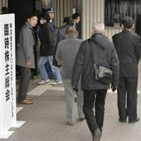 Damage control: Maruha Nichiro Holdings Inc. investors gather Thursday for an extraordinary general shareholders' meeting in Minato Ward, Tokyo. | KYODO