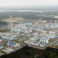 Full steam ahead: Japan Nuclear Fuel Ltd.'s reprocessing plant in Rokkasho, Aomori Prefecture, is seen in June 2012. | KYODO