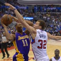 Not in my house: Clippers forward Blake Griffin (32) tries to block a shot by the Lakers' Wesley Johnson during their game on Friday in Los Angeles. The Clippers won 123-87. | AP
