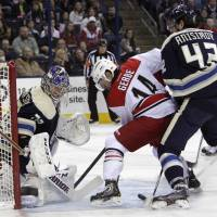 Down home blues: Blue Jackets goalie Sergei Bobrovsky, left, makes a save against the Hurricanes' Nathan Gerbe on Friday. | AP