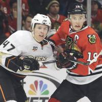 No quarter given: Chicago's Jonathan Toews (right) and Anaheim's Hampus Lindholm vie for the puck during the Blackhawks' 4-2 win on Friday. | AP