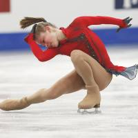 Youth movement: Russia's Julia Lipnitskaia performs her free-skate routine at the European Figure Skating Championships on Friday. | AP