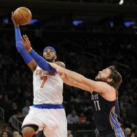 All day long: Knicks forward Carmelo Anthony goes up for a shot against the Bobcats' Josh McRoberts on Friday. | AP