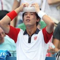 Cool your jets: Kei Nishikori cools off during his semifinal match against Lleyton Hewitt at the Brisbane International on Saturday. | AP