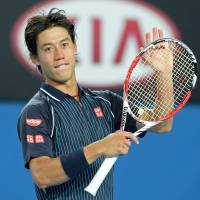 Satisfied: Kei Nishikori waves to fans after beating Donald Young in the third round 7-5, 6-1, 6-0 on Saturday at the Australian Open. | AFP-JIJI