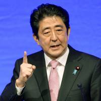 Abe takes aim at pacifist Constitution
