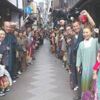 Suited up: Participants in a Kimono Jack event gather at the historic Pontocho Alley in central Kyoto in November 2012. | KIMONO JACK