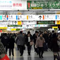 Sea of humanity: People walk through an underground passage at JR Shinjuku Station. More than 3 million people pass through or use the giant transport hub each day. | SATOKO KAWASAKI