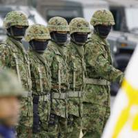 Eyes right: Ground Self-Defense Force personnel line up at the GSDF's Asaka base in Nerima Ward, Tokyo, in 2007. | KYODO