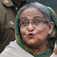 Ask away: Bangladesh Prime Minister Sheikh Hasina listens to a question during a news conference in Dhaka on Monday. | AP