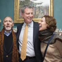 Open door: New York Mayor Bill de Blasio (center) poses for pictures with visitors at Gracie Mansion, the official residence of the mayor, during an open house and photo opportunity with the public as part of the inauguration ceremonies on Jan. 5. | AP