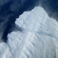 Point of no return: An iceberg breaks off Pine Island Glacier's calving front. | NASA ICE