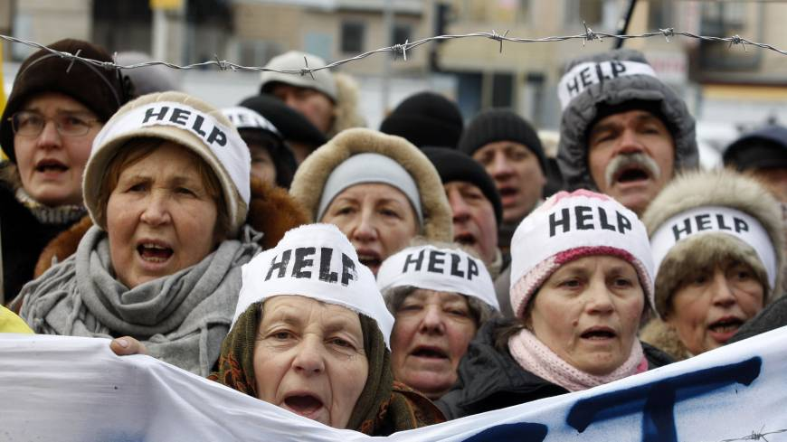 Protesters wearing headbands shout slogans during a rally urging European Union sanctions in the capital the same day.
