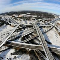 A fisheye view shows Atlanta's ice-covered interstate system the same day. While such amounts of snow barely qualify as a storm in the northern U.S., they were enough to paralyze the Deep South. | AP
