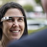 Glass action: Cecilia Abadie wears her Google Glass on Dec. 3 while speaking with her attorney in San Diego. | AP