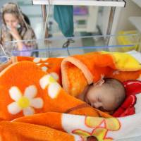 Precious few: Asal, a 16-day-old baby girl, sleeps in her cot in the Neonatal Intensive Care Unit of Mofid Children's Hospital in Tehran on Dec. 30. Having curbed birthrates for two decades, Iran is once again promoting a baby boom to help make up for its graying population. | AP