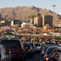 Border line: Vehicles line up to cross into El Paso, Texas, from Ciudad Juarez, Mexico, over the Paso del Norte Bridge on Dec. 26. | AP