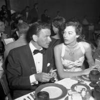 Ol' blue eyes: Frank Sinatra and Ava Gardner hold cigarettes as they dine together in Reno, Nevada, in August 1951. | AP