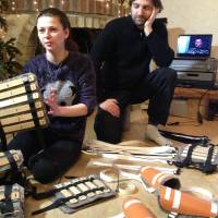 Helping hands: Marianna Kvyatkovska and Alexander Bitkin fashion homemade shinguards and elbow pads from plastic drainage pipes at their home in Lviv, Ukraine, on Saturday. | AP