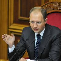 Listen up: Parliament Speaker Arseniy Yatsenyuk addresses the legislature in Kiev in September 2008. | AFP-JIJI