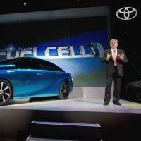 The future is here: Bob Carter, a Toyota vice president and general manager, talks about Toyota's FCV hydrogen electric concept car at the International Consumer Electronics Show in Las Vegas on Monday. | AP