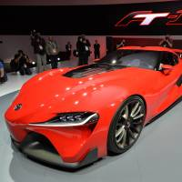 The future: Reporters view the Toyota FT-1 concept car during a press preview at the Detroit auto show that began Monday. | AFP-JIJI