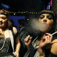 Smoke easy: Women celebrate the start of retail pot sales at a Prohibition-themed New Year's Eve party at a bar in Denver. | AP
