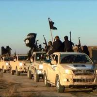 Road warriors: An image posted on a militant website Tuesday, shows a convoy of vehicles from the al-Qaida linked Islamic State of Iraq and the Levant in Iraq's Anbar province. | AP