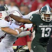 Spartan regime: Michigan State wide receiver Bennie Fowler breaks through the Stanford defense on Wednesday. | AP