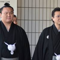 Yokozuna Hakuho and Isegahama Oyakata, representing Harumafuji, attend a yusho portrait award ceremony one day prior to the start of the Hatsu Basho. | MARK BUCKTON