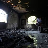 Looking for clues: A Libyan investigates the interior of the U.S. Consulate in Benghazi on Sept. 13, 2012, after an attack killed four Americans, including Ambassador Chris Stevens. | AP