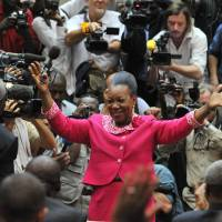 Electing for hope: Bangui Mayor Catherine Samba-Panza waves to members of the Central African Republic's transitional council after being elected interim president of the strife-hit nation Monday in the capital. | AFP-JIJI