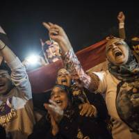 Moving forward: Egyptians celebrate in Cairo's Tahrir Square on Saturday after a new constitution was approved. | AFP-JIJI