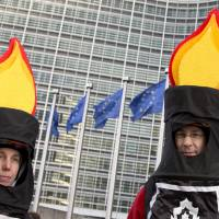 Groundswell of opposition: Protesters from an anti-fracking group wait for the start of a demonstration outside EU headquarters in Brussels on Wednesday. | AP
