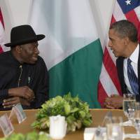 Opposite sides: U.S. President Barack Obama meets with Nigerian President Goodluck Jonathan in New York last September. According to an Associated Press report, Jonathan signed a previously unannounced Same Sex Marriage Prohibition Act that bans same-sex marriage and criminalizes homosexual associations, societies and meetings, with penalties of up to 14 years in prison, on Jan. 7. | AP