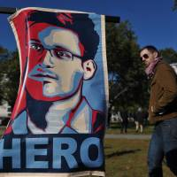 How it all started: A portrait declaring fugitive former U.S. National Security Agency contractor Edward Snowden a 'hero' is displayed during a protest against government surveillance in Washington on Oct. 26. | AFP-JIJI