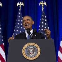 In major speech, Obama sets limits, overhauls controversial surveillance program