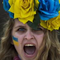 Solidarity: A protestor shouts slogans during a demonstration in support of Ukraine's unrest against President Viktor Yanukovych's government in Madrid on Sunday. | AP