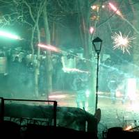 Explosive situation: A flash grenade explodes in Kiev on Monday amid clashes between security forces and protesters seeking the ouster of Ukrainian President Viktor Yanukovych. | AFP-JIJI