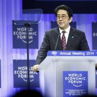 Prime Minister Shinzo Abe speaks during a session on the opening day of the World Economic Forum in Davos, Switzerland, on Wednesday. | BLOOMBERG