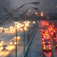 Freakish: Traffic crawls along the I-20 on Tuesday in Atlanta. Tuesday's storm deposited barely enough to qualify as a storm up North, yet was more than enough to paralyze Deep South cities such as Atlanta and Birmingham and strand thousands of workers trying to rush home early. | AP